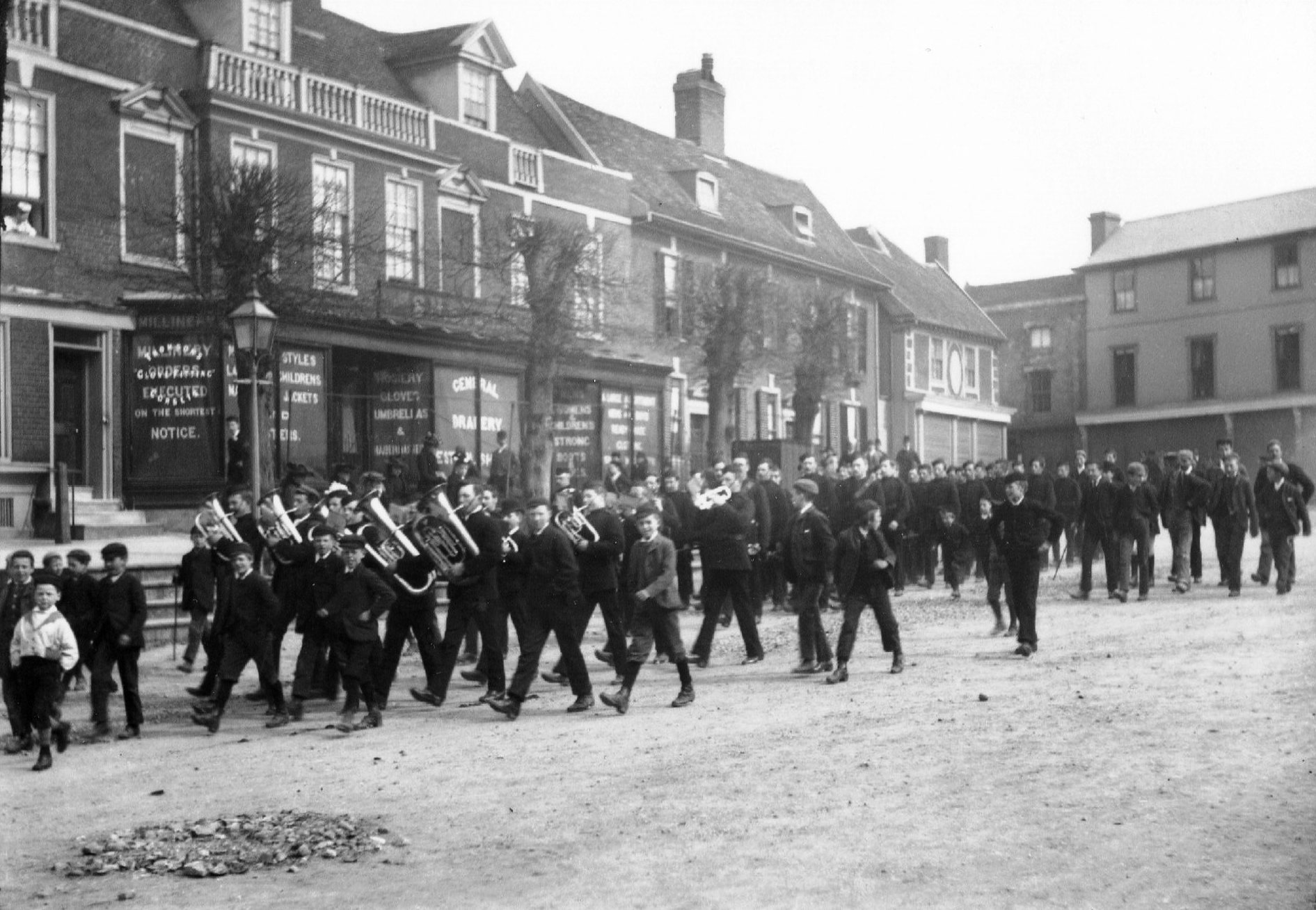 Band marching down Market Hill