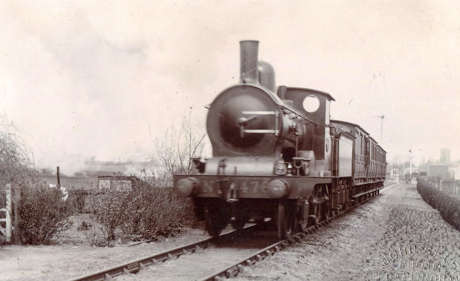 No 476 leaves the station, c.1905